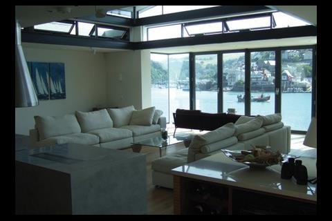 The living room rejoices in a 180 degree panorama of the river along with daylighting and fresh air through clerestorey windows